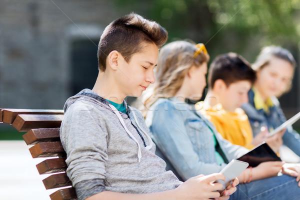 Boldog tizenéves fiú táblagép számítógép kint technológia Stock fotó © dolgachov