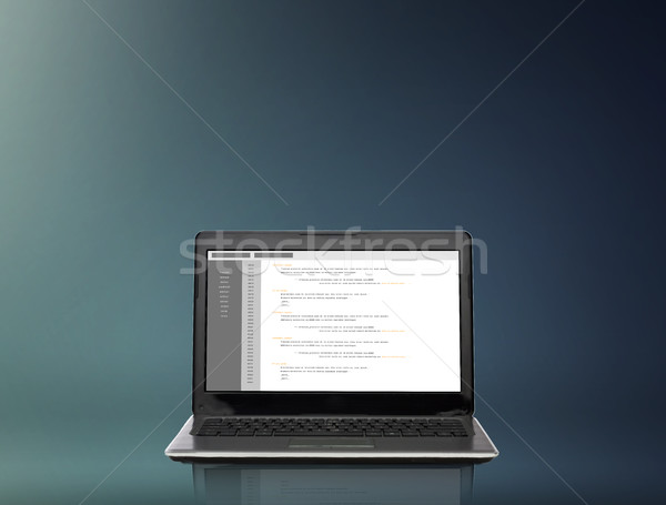 laptop computer with coding on screen Stock photo © dolgachov