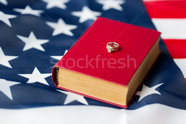 Közelkép amerikai zászló jegygyűrűk Biblia polgári jogok család Stock fotó © dolgachov