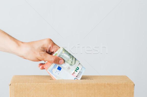 Hombre euros dinero donación cuadro caridad Foto stock © dolgachov