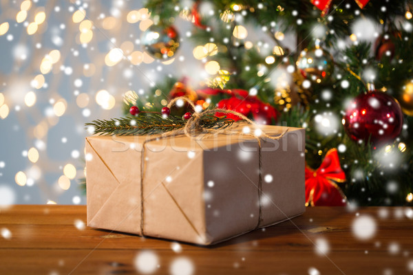 close up of christmas gift with fir branch Stock photo © dolgachov