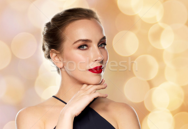 beautiful woman in black over holidays lights Stock photo © dolgachov
