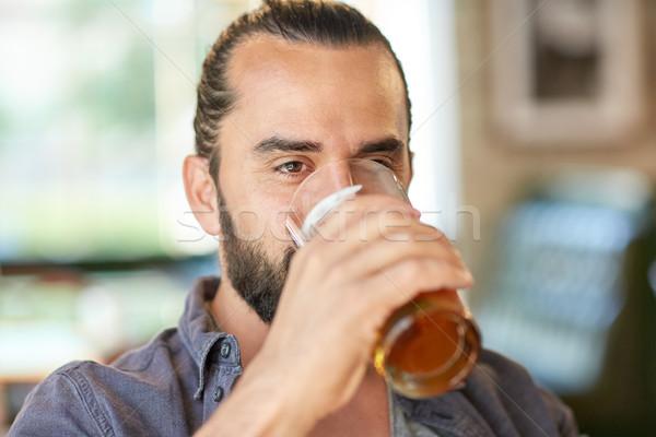 close up of man drinking beer at bar or pub Stock photo © dolgachov