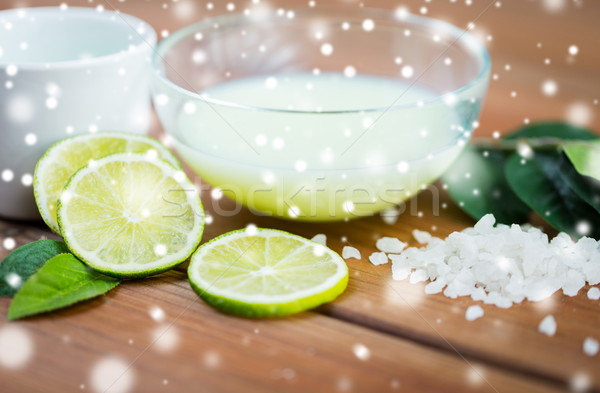 body lotion in bowl and limes on wood Stock photo © dolgachov