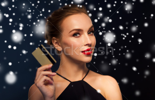 beautiful woman with credit card over snow Stock photo © dolgachov