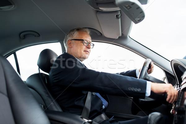 happy senior businessman starting car and driving Stock photo © dolgachov
