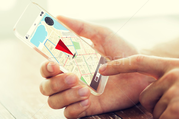 close up of hand with navigator map on smartphone Stock photo © dolgachov