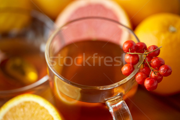close up of tea cup with rowanberry Stock photo © dolgachov