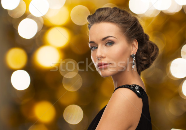 Mulher vestido de noite brinco pessoas férias jóias Foto stock © dolgachov