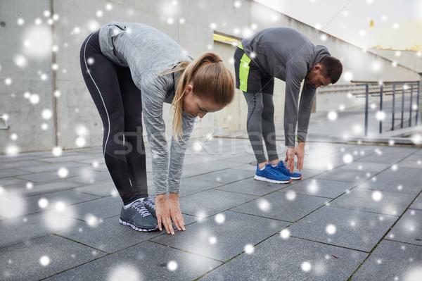 Pár nyújtás görbület előre fitnessz sport Stock fotó © dolgachov