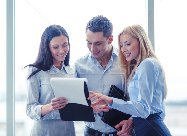 business team looking at clipboard Stock photo © dolgachov
