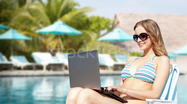 happy young woman in shades with laptop on beach Stock photo © dolgachov