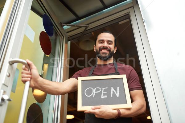 man or waiter with blackboard at bar entrance door Stock photo © dolgachov