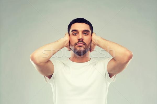 Hombre orejas mano palmas problema emoción Foto stock © dolgachov
