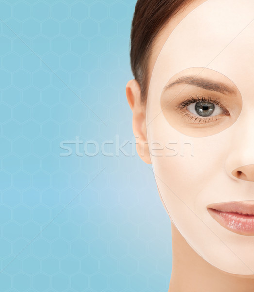 close up of woman with collagen facial mask Stock photo © dolgachov