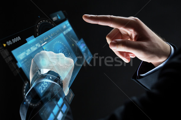 close up of businessman hands with smartwatch Stock photo © dolgachov