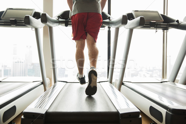 man exercising on treadmill in gym Stock photo © dolgachov