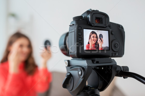 woman with eyebrow pencil recording video at home Stock photo © dolgachov