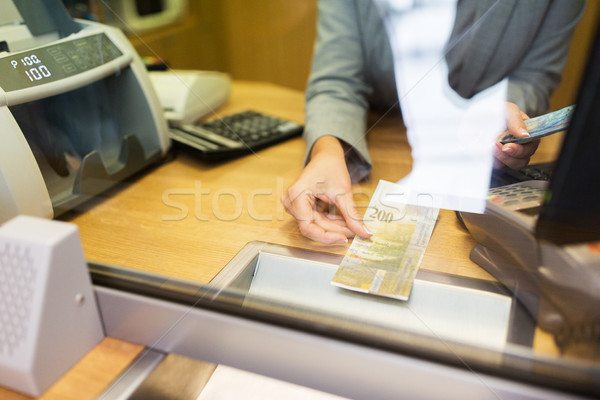 Stock photo: clerk counting cash money at bank office