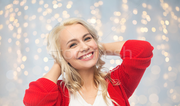 Feliz sorridente mulher jovem vermelho cardigã moda Foto stock © dolgachov