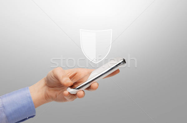 woman with smartphone and antivirus program icon Stock photo © dolgachov