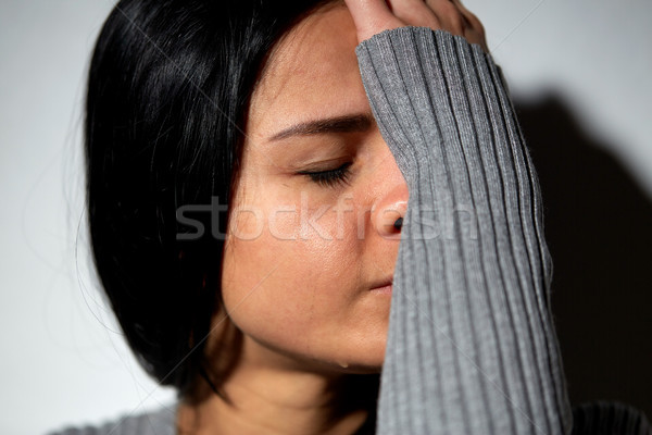Stock photo: close up of unhappy crying woman