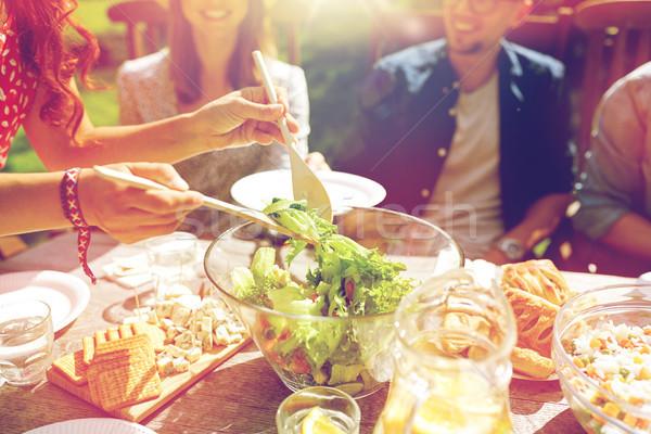 happy friends having dinner at summer garden party Stock photo © dolgachov
