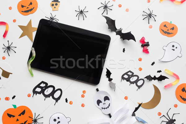tablet pc, halloween party decorations and candies Stock photo © dolgachov