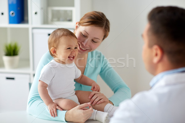 happy woman with baby and doctor at clinic Stock photo © dolgachov