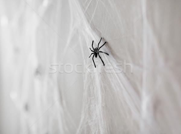 halloween decoration of black toy spiders on web Stock photo © dolgachov