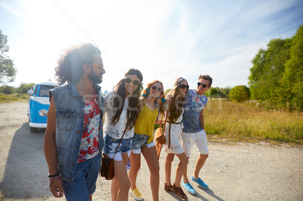 smiling happy young hippie friends at minivan car Stock photo © dolgachov