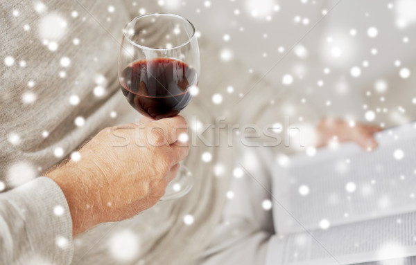 close up of senior man with wine glass and book Stock photo © dolgachov