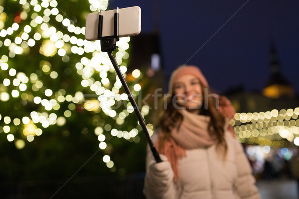 young woman taking selfie at christmas town Stock photo © dolgachov