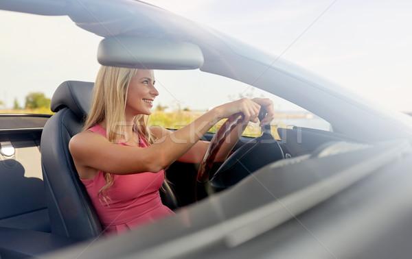 happy young woman driving convertible car Stock photo © dolgachov