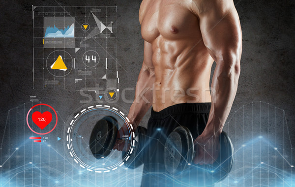 close up of man with dumbbells exercising Stock photo © dolgachov