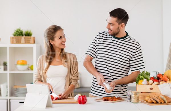 happy couple cooking food at home kitchen Stock photo © dolgachov