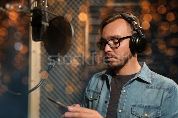 Cantante cuffie musica show uomini d'affari Foto d'archivio © dolgachov