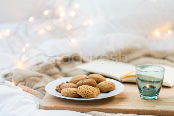 oatmeal cookies and candle in holder at home Stock photo © dolgachov