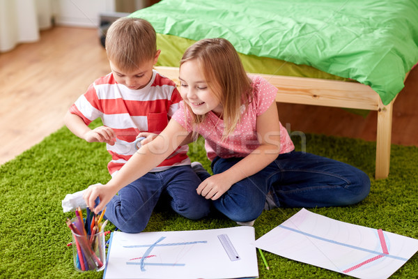 happy creative kids drawing at home Stock photo © dolgachov