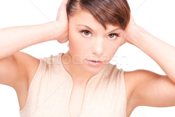 Stock photo: unhappy woman with hands on ears