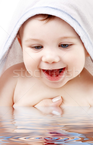 happy baby with terry hoodie robe on head Stock photo © dolgachov