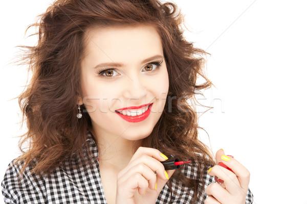 beautiful woman polishing her nails Stock photo © dolgachov
