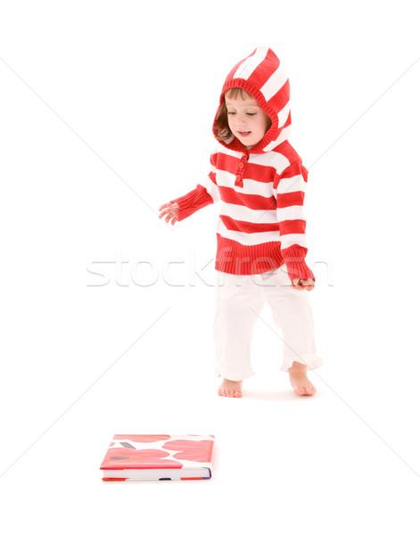 Petite fille photos livre blanche enfant personne Photo stock © dolgachov