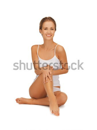 woman in cotton undrewear touching her legs Stock photo © dolgachov