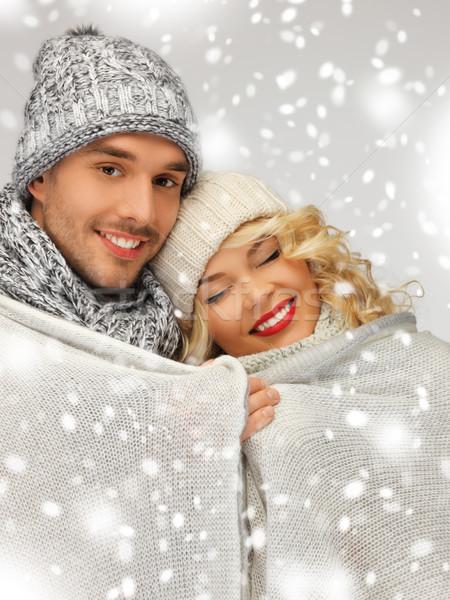 family couple under warm blanket Stock photo © dolgachov