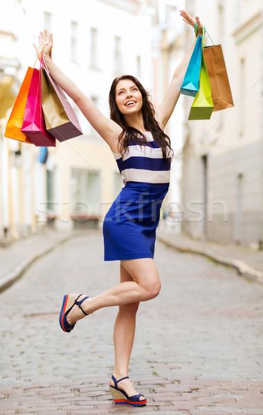 woman with shopping bags in ctiy Stock photo © dolgachov