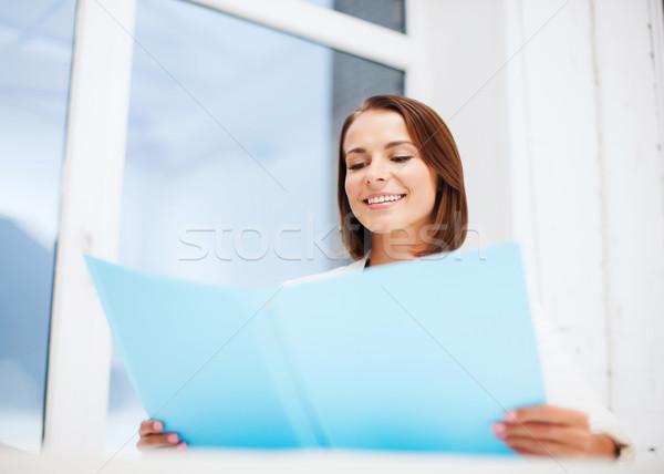 businesswoman with folder in office Stock photo © dolgachov