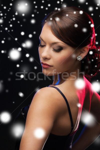 woman in evening dress wearing diamond earrings Stock photo © dolgachov