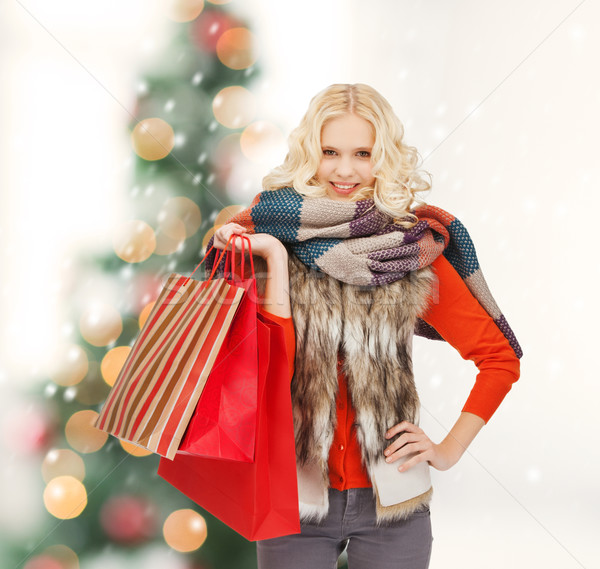 teenage girl in winter clothes with shopping bags Stock photo © dolgachov