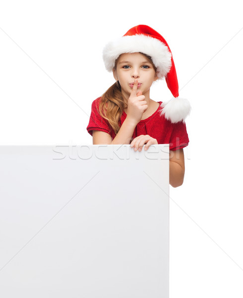 child in santa helper hat with blank white board Stock photo © dolgachov